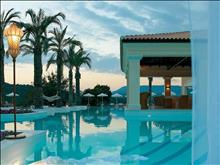 Grecotel Eva Palace: Palm fringed Pool Landscape and Swim up Bar